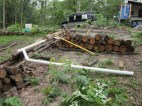 stacking logs like terraces to hold the raised beds together.