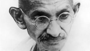 Gandhi, looking pensive
