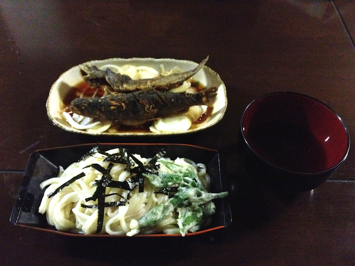 homemade udon, grilled fish on a bed of soy grilled onions and an empty bowl of hot miso soup (it was a cold day)
