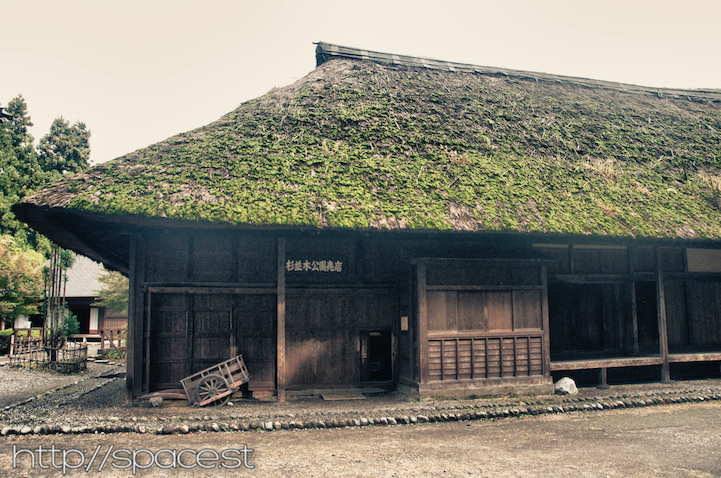 the old thatched roof workers' quarters and horse stables