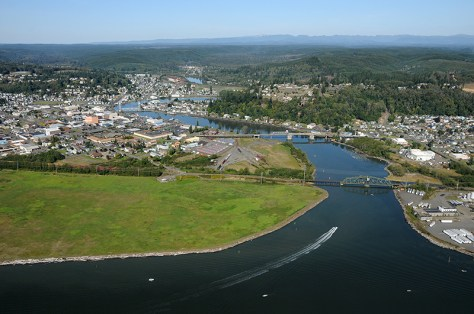 An aerial view of Grays Harbor, WA, where planned crude oil terminals threaten treaty-protected fishing and gathering rights.