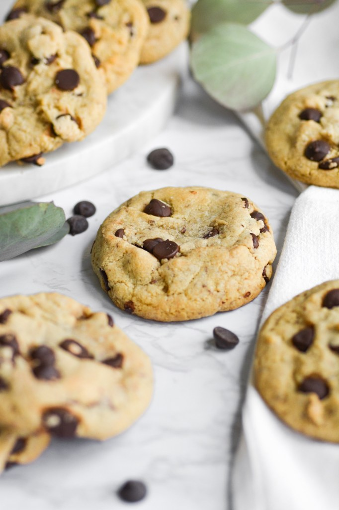 portrait of chocolate chip cookies on a marble board