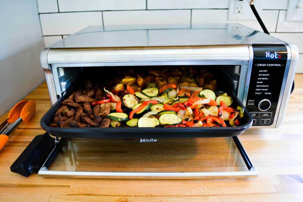 Sheet pan of Seitan and vegetables in the Food oven