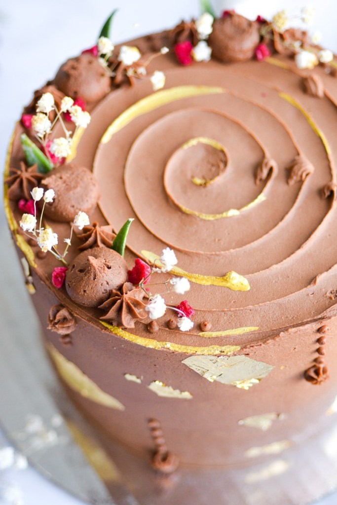 Close up of a cake frosted with Vegan Chocolate Buttercream Frosting