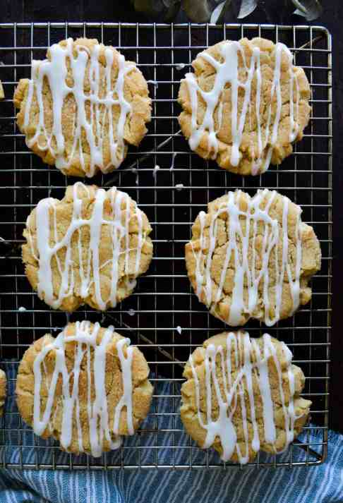 glazed scickerdoodle cookies on a cooling rack