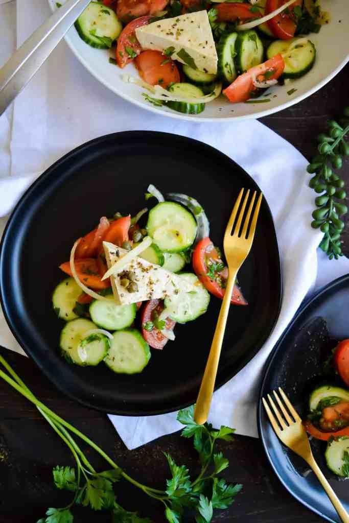 close up portrait of salad on black plate