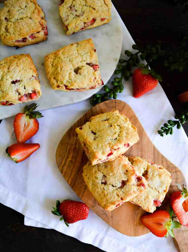 Portrait of scones laid out on cuttingboards