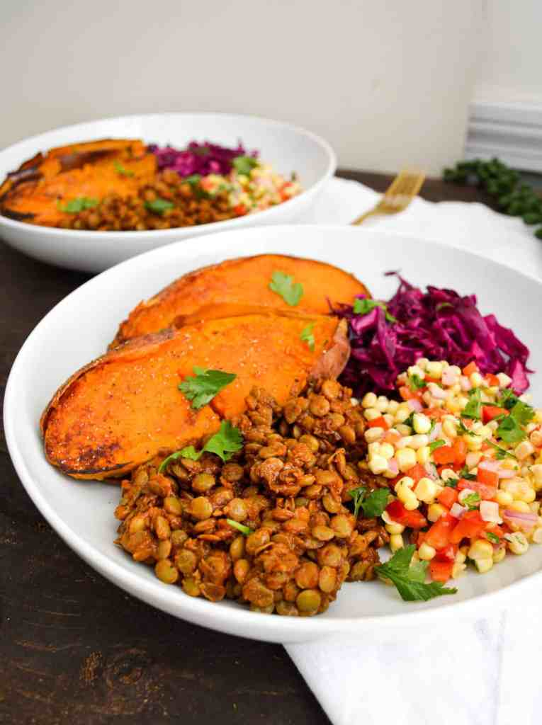 Quick + Smoky Barbecue Lentils in a bowl with sweet potatoes and corn salsa