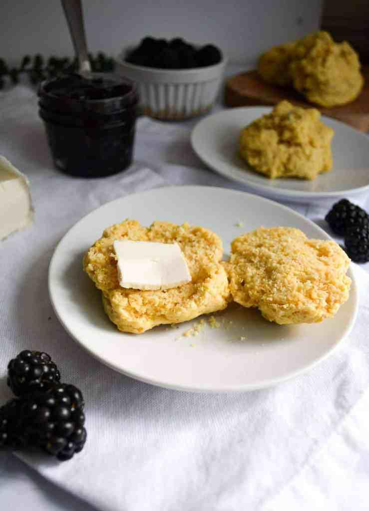 Butter on a split open Fluffy Cornmeal Drop Biscuit