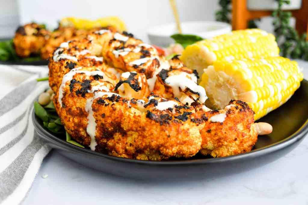 Close up of harissa butter grilled cauliflower steaks