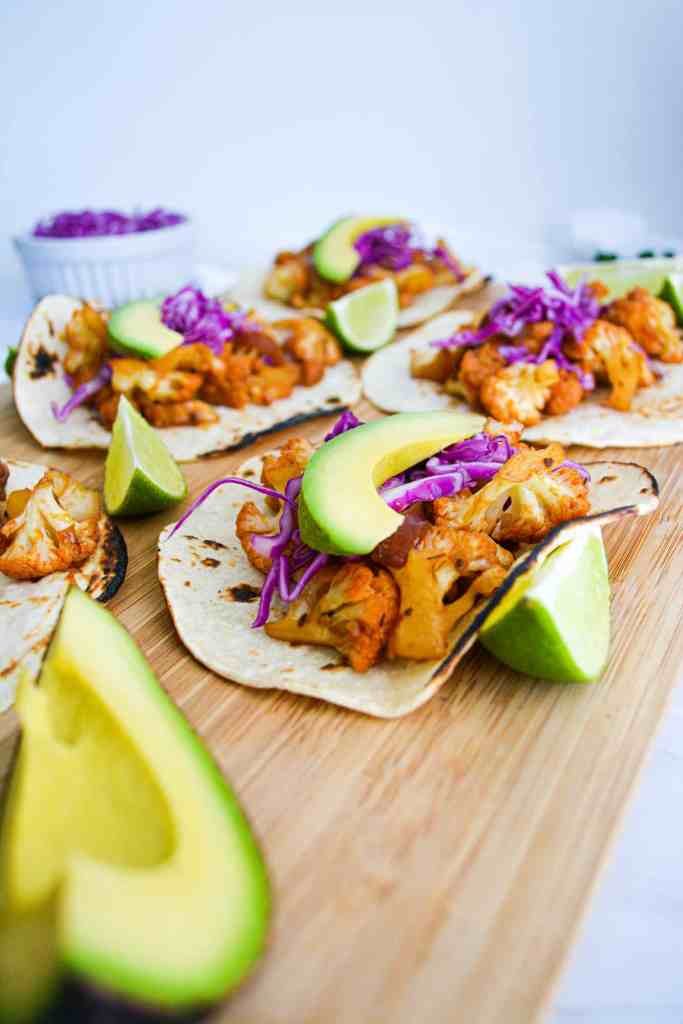 Portrait of Agave Chipotle Cauliflower Tacos on a wooden  cutting board