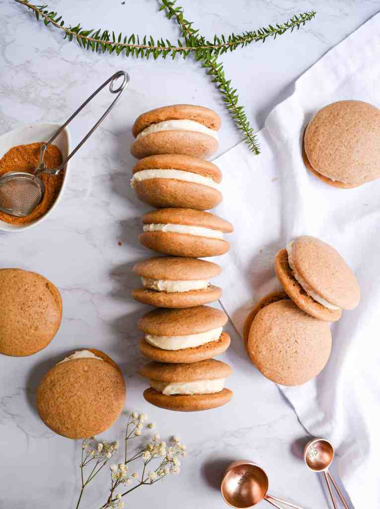 One-Bowl Chai Spiced Whoopie Pies filled with vanilla buttercream and lined up.