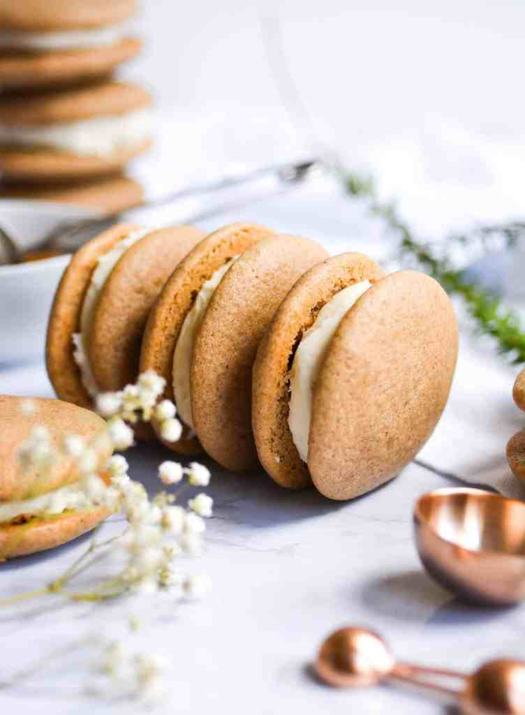 Close up of three one-bowl chai spiced whoopie pies on a white background