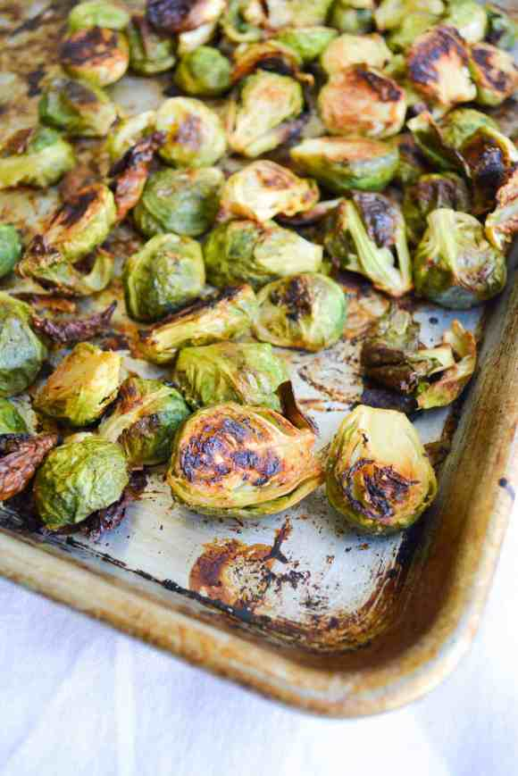 Roasted Maple Dijob Brussels Sprouts on a metal sheet pan