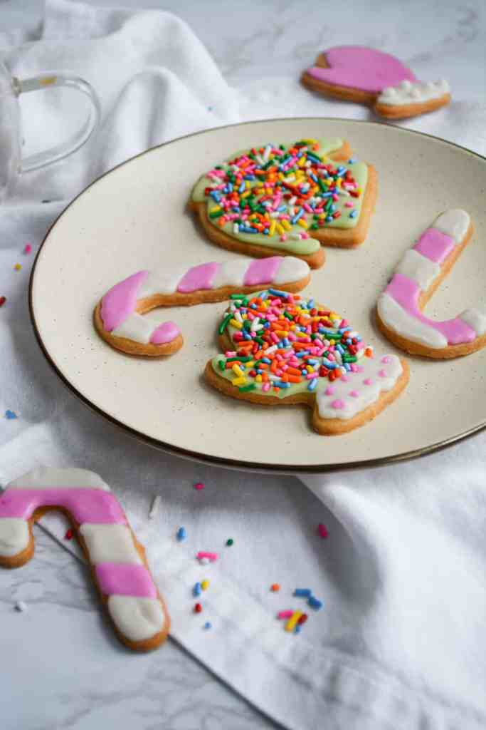 Vegan Cut-Out Holiday Cookies decorated with royal icing on a plate