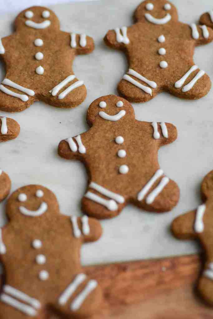 Close up of gingerbread cookies on a marble cutting board
