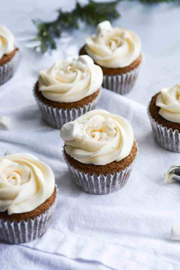 Gingerbread cupcakes on a white table
