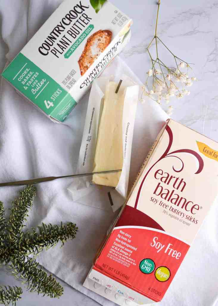 a package of soy-free earth balance and a package or country crock plant butter on a white cloth napkin