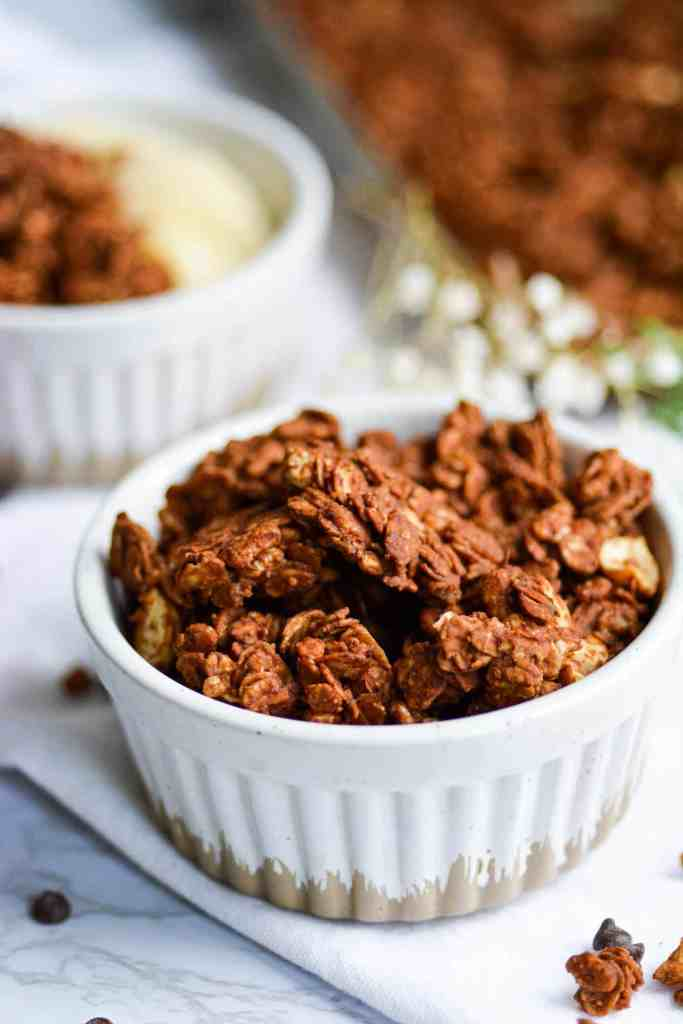 Close up of peanut butter cup granola clusters in a ramekin