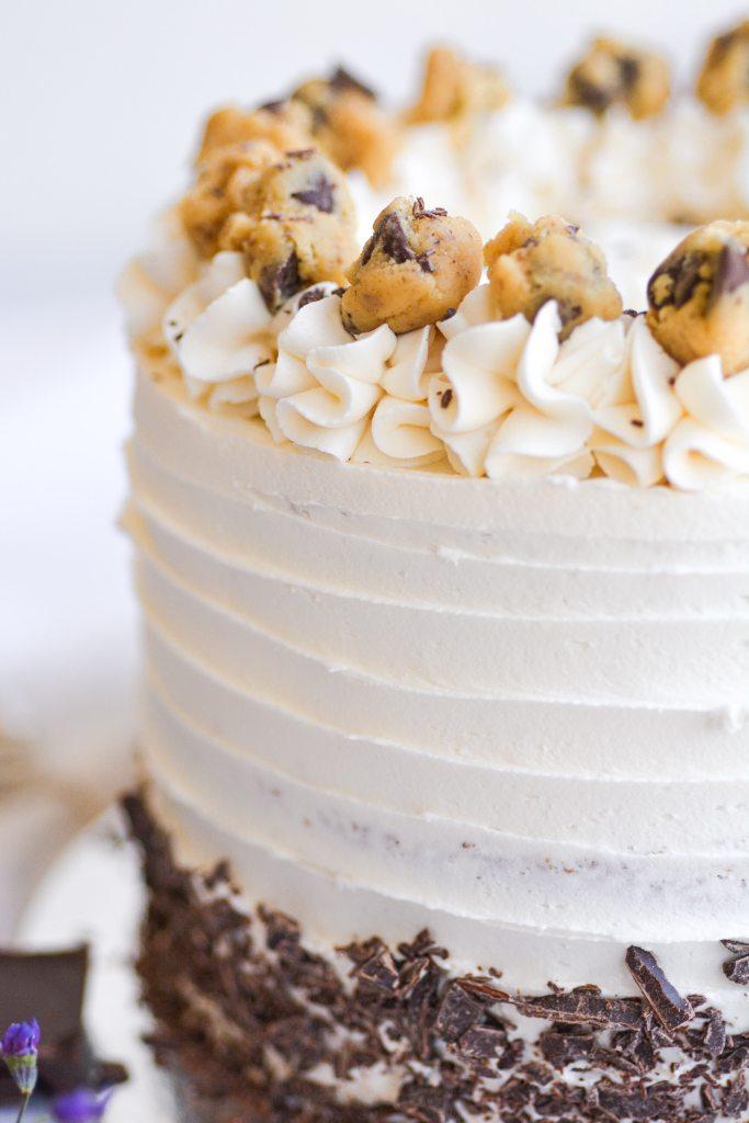 Close up of cooke dough balls atop the cake