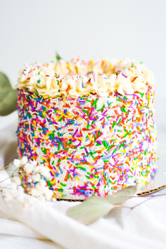 egg free and dairy free funfetti cake on a white board
