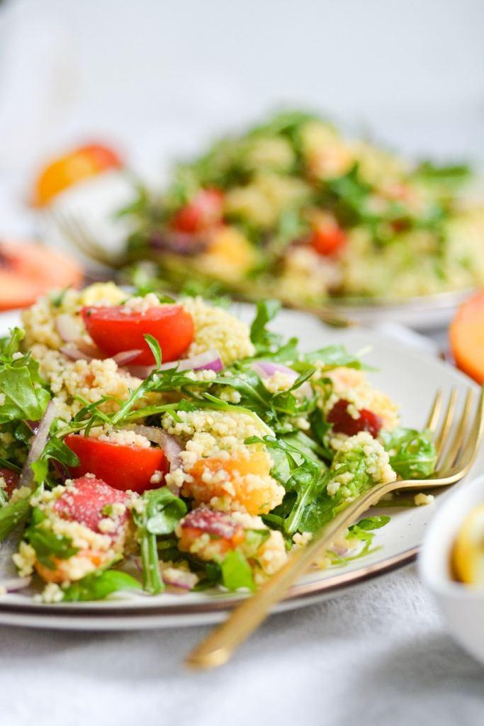 two plates of vegan couscous salad