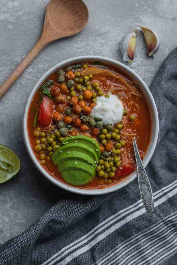 Vegan rice noodle soup with vegetables and chickpeas