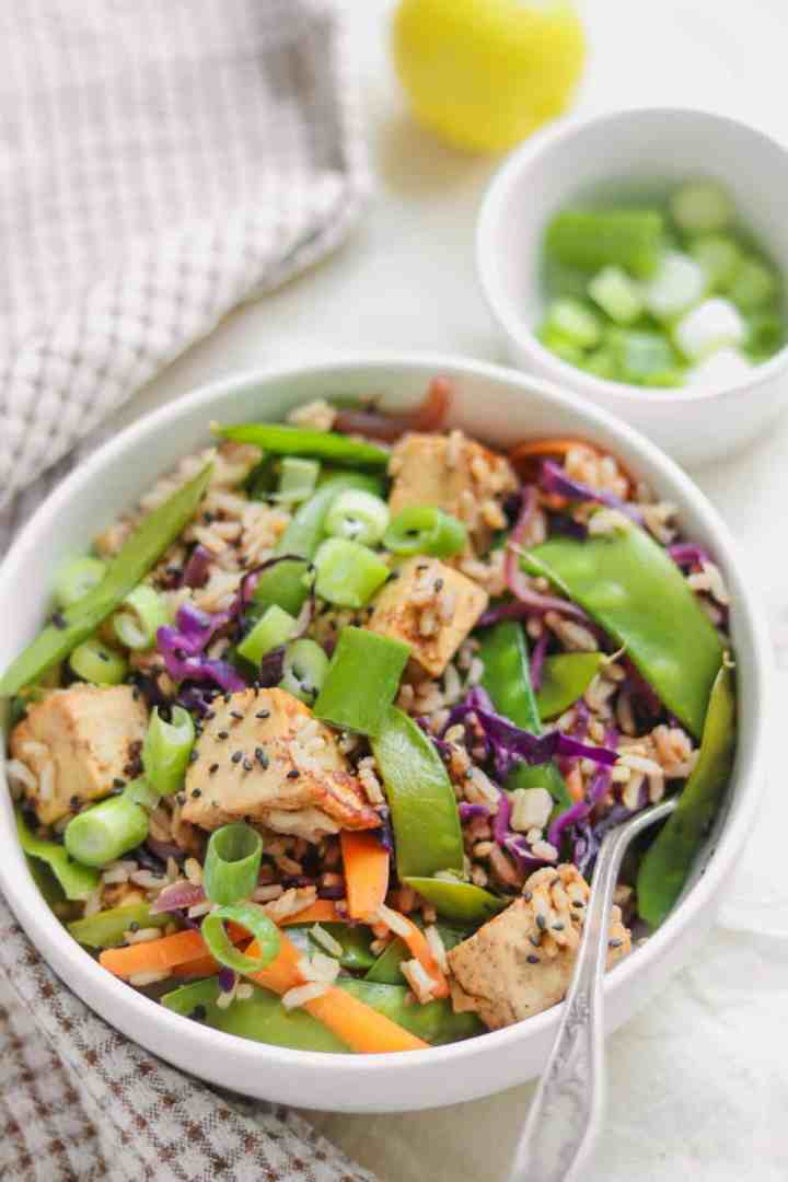 Tofu rice stir-fry with almond butter and vegetables