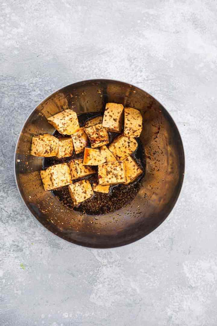 Tofu marinading in a bowl
