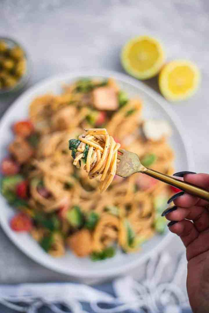 Spaghetti on a fork with a tahini sauce