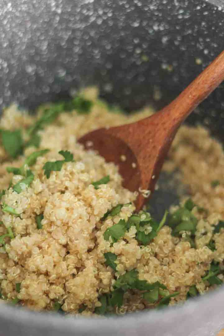 Quinoa with lemon juice and fresh coriander in a saucepan