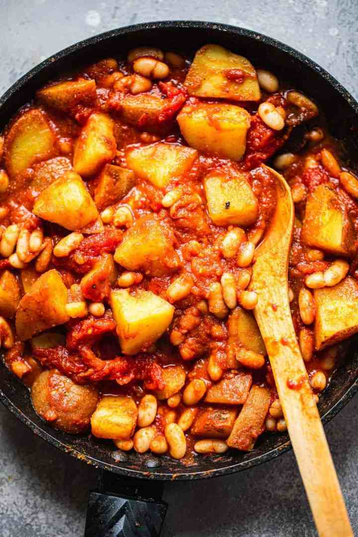 Potatoes and white beans in a frying pan