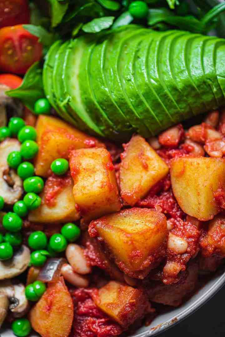 Closeup of vegan bowl with potatoes and avocado