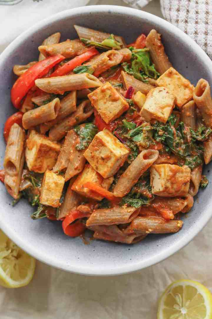 Healthy vegan tomato sauce pasta with tofu and red pepper