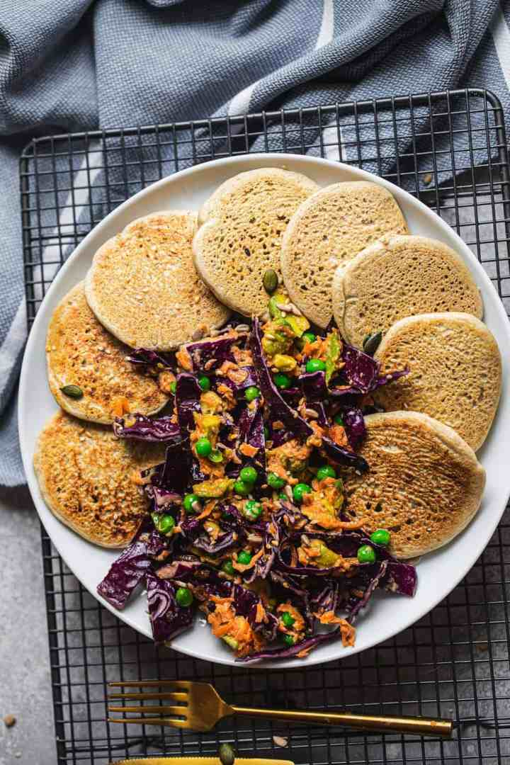 Plate of vegan pancakes with vegetables
