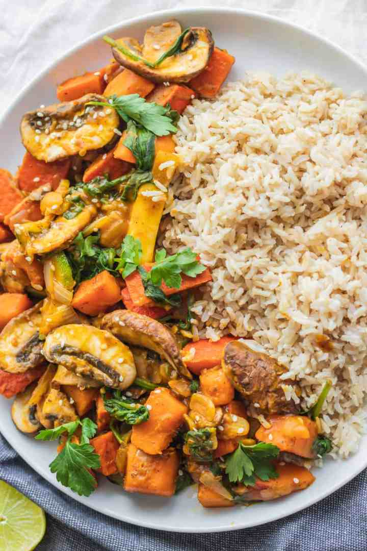 Healthy pumpkin stir-fry with mushrooms, zucchini and rice