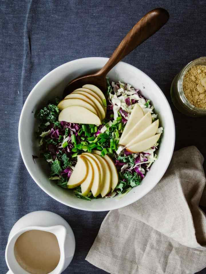 Crunchy Apple Kale Slaw With Balsamic Tahini Dressing And Almond Parmesan