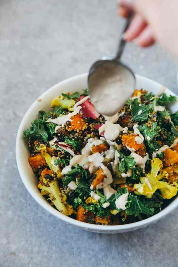 Roasted Veggie Quinoa Salad With Tahini Garlic Dressing
