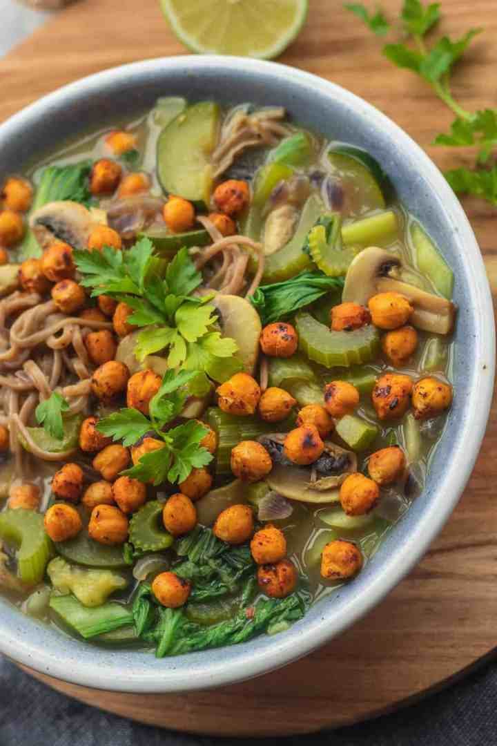 Closeup of vegan soup with noodles and roasted chickpeas