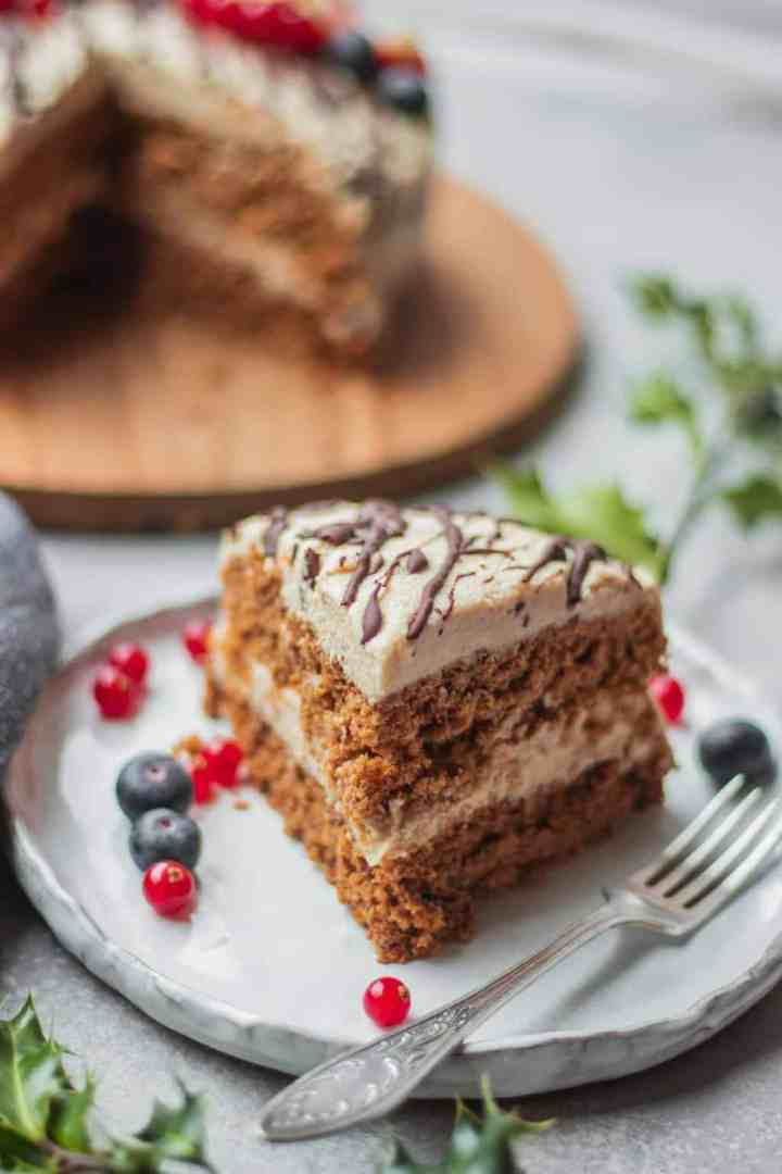 Slice of vegan Christmas cake with coconut frosting