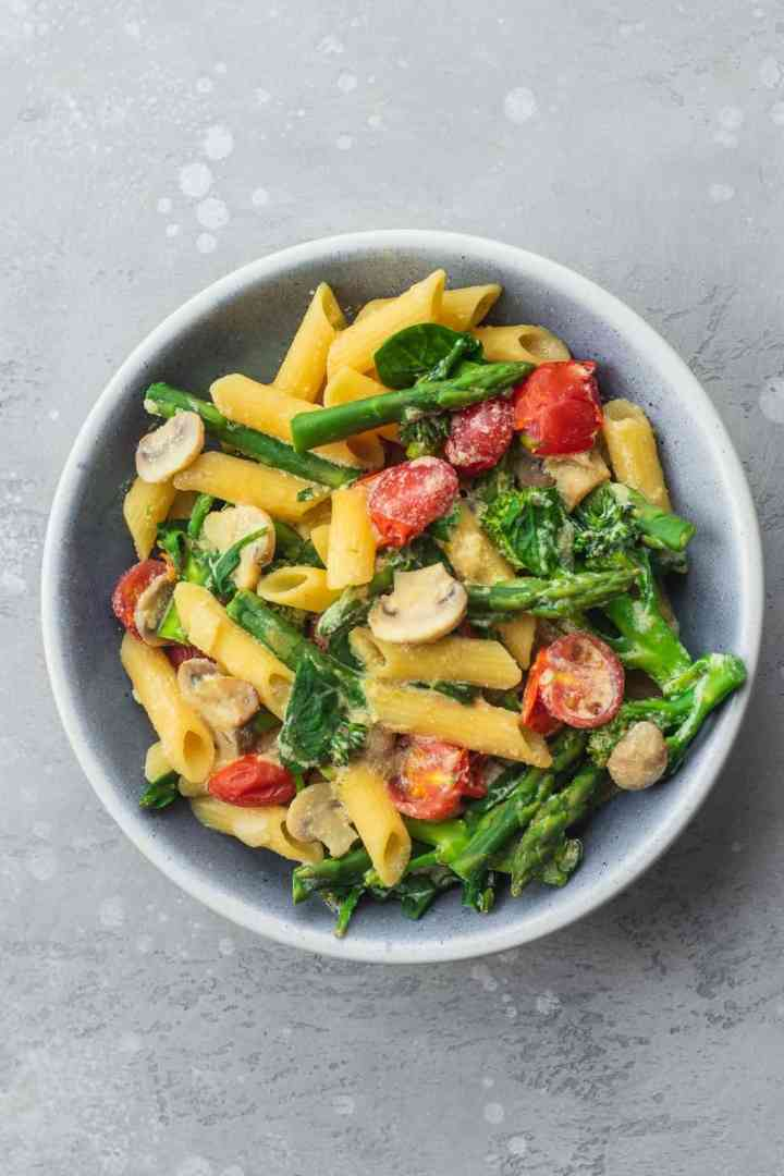 Vegan tofu pasta with asparagus and broccoli