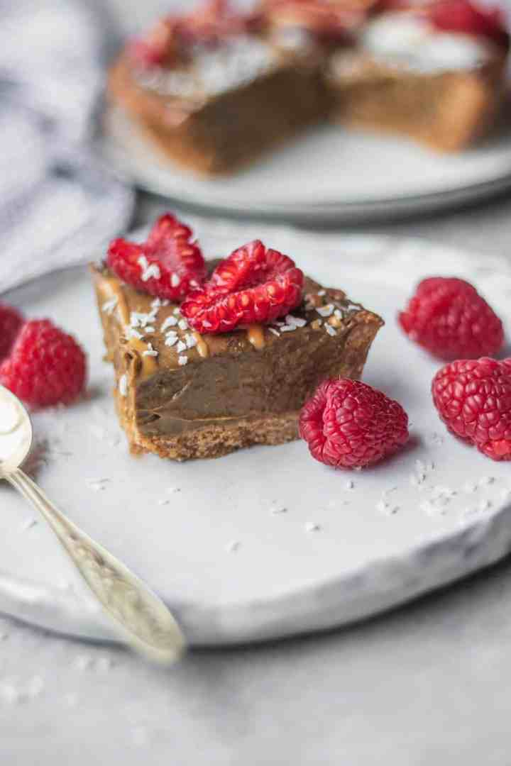 Vegan chocolate avocado mousse tart with raspberries