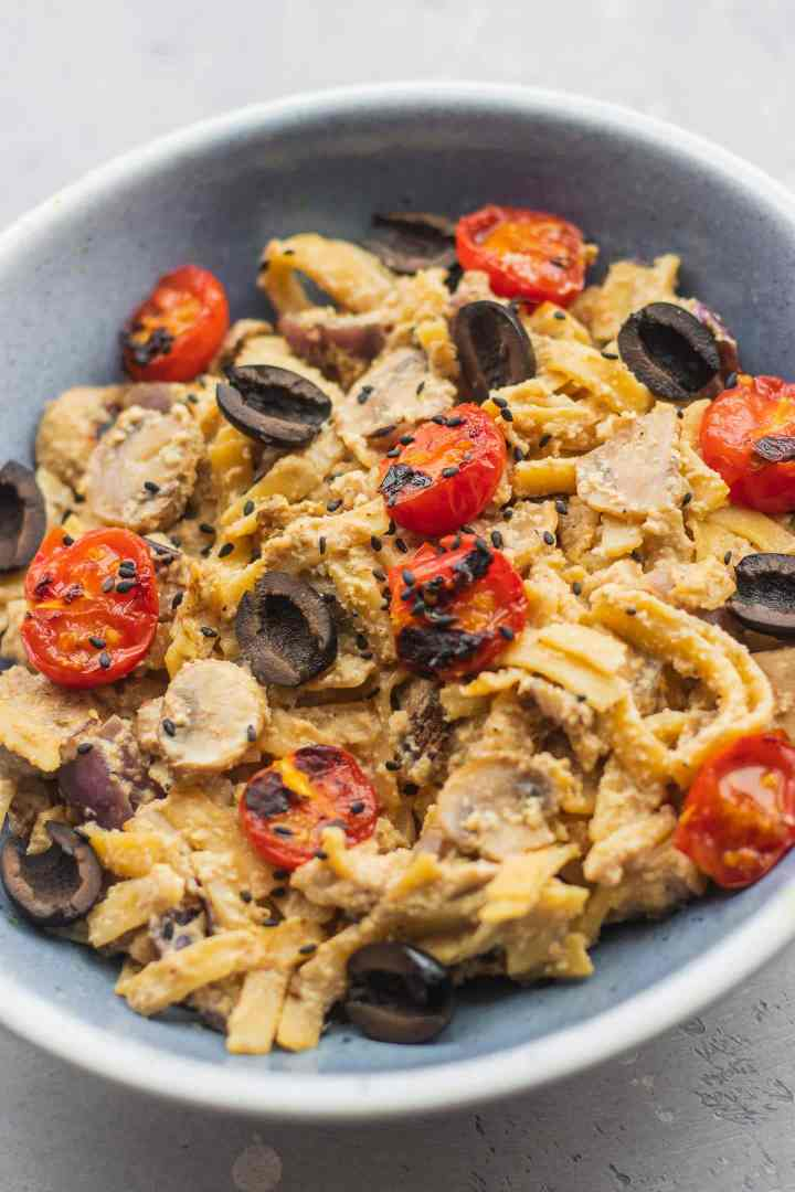Vegan fetucchini Alfredo with tomatoes and olives