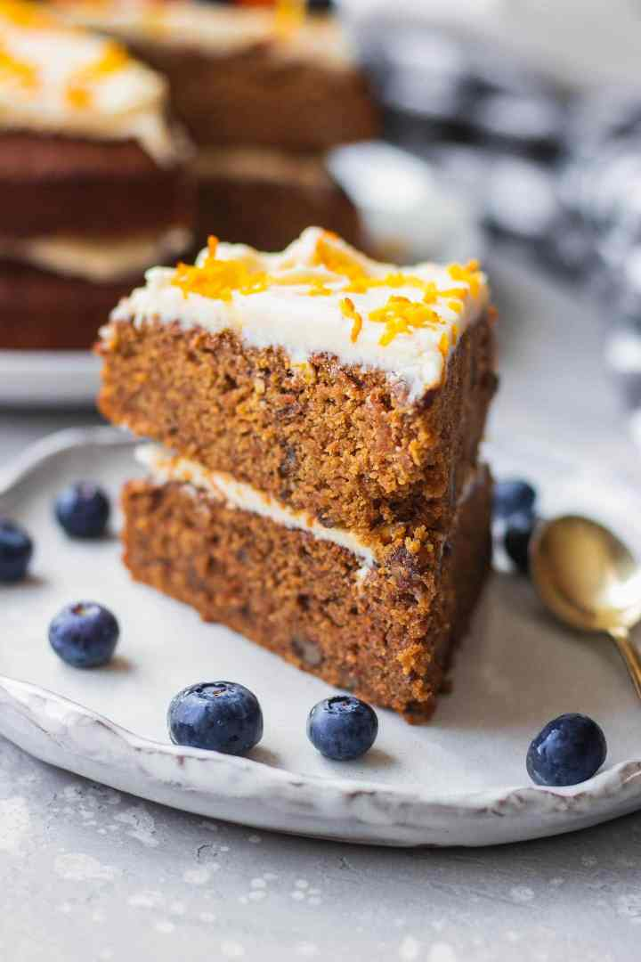 Vegan cake with frosting on a white plate