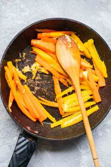 Carrots and bell pepper in a frying pan