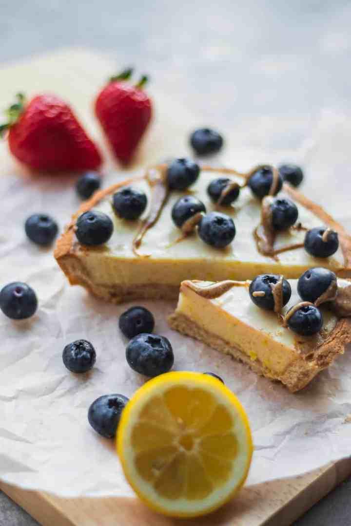 Slice of gluten-free lemon tart with berries