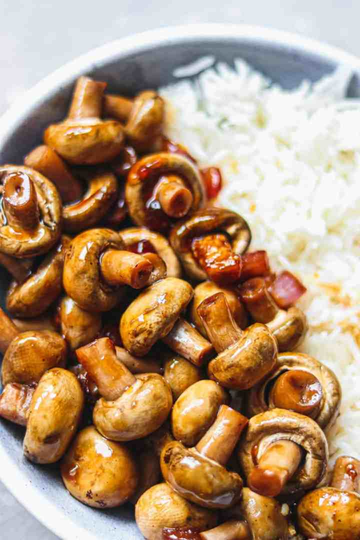 Glazed mushrooms and rice in a blue bowl