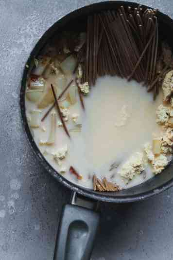 Saucepan with noodles and coconut broth