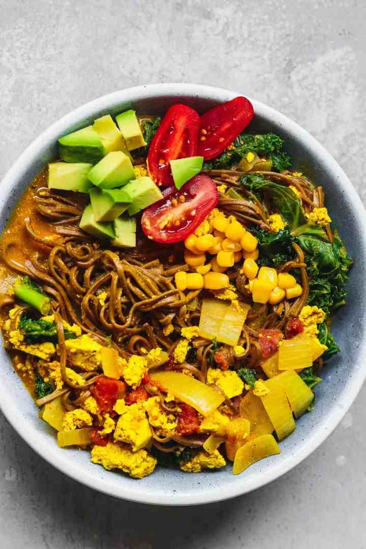 Blue bowl with noodles tofu and vegetable