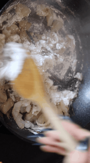 Onion and flour in a frying pan